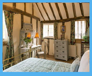 country cottage bedroom with exposed beams